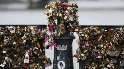A view shows the Pont des Arts with its fence covered with thousands of padlocks clipped by lovers over the River Seine in Paris